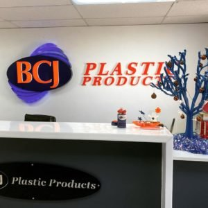 BCJ Plastic Products Logo with Blue Tree