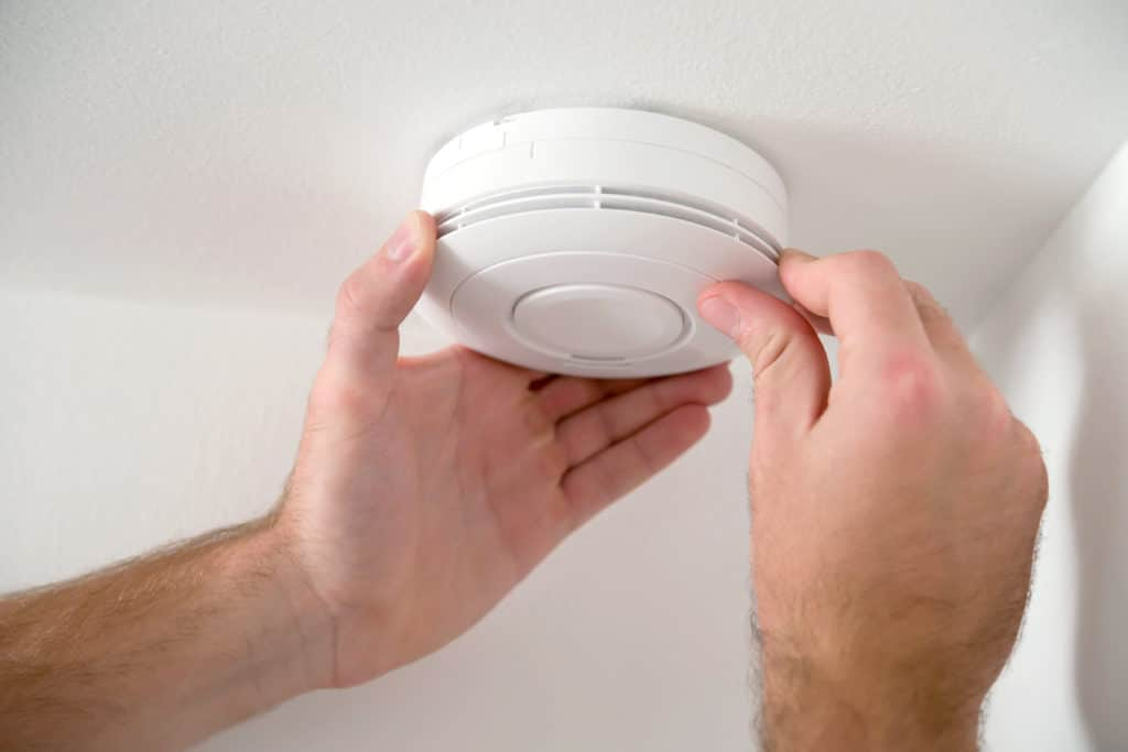 Man installing smoke detector BCJ Plastic Products